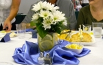 Daisies, lemon wedges and blue shards made up the table decorations